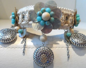 Mother of pearl effect petal and bead flower with metal drop surround. OOAK.