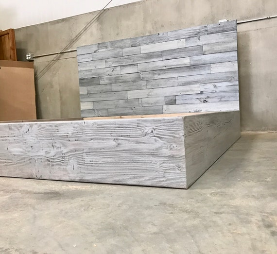 The Amanda grey driftwood finished bed with horizontal staggered patched recycled reclaimed wood headboard