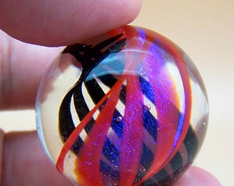Beautiful large clear lampwork glass marble, double helix of twisted ribbons in black, red and gossamer veil suspended inside, art marble