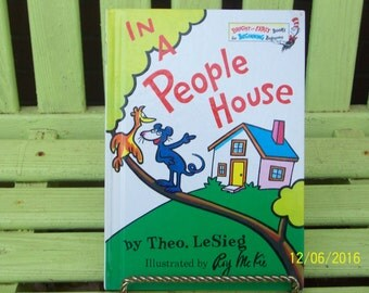 In a People House by Theo. LeSieg (Dr. Seuss) and illustrated by Roy McKie