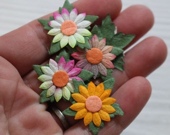 Multicoloured paper daisies