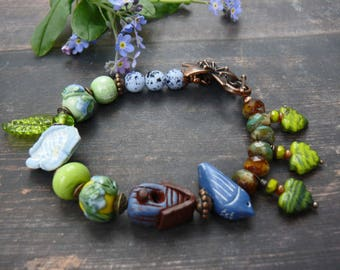The Bluebird of Happiness - rustic blue yellow green bird house leaf floral spring bracelet.