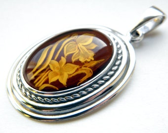 Hand carved baltic amber sterling silver flower pendant