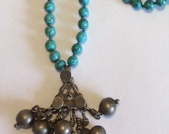 Long Knotted Turquoise Necklace with Antique Silver Pendant with Silver Toggle Clasp