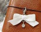 Sparkly white bow charm