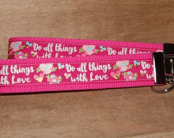 """Mother's Day Special: Buy one regular wristlet and get a floral mini free.  Keyfob quote """"Do All Things With Love"""". Keychain/Keyfob/Wristlet"""