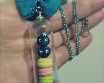 Glass dome necklace.