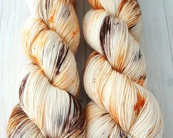 """Hand dyed """"Carrot Cake"""" superwash merino sock yarn"""