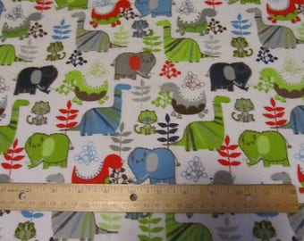 White with Multicolored Dinosaur/Mammoth  Flannel Fabric by the Yard