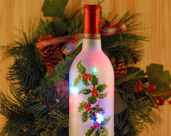 Christmas holly wine bottle lamp, hand painted, frosted bottle filled with multicolored Christmas lights