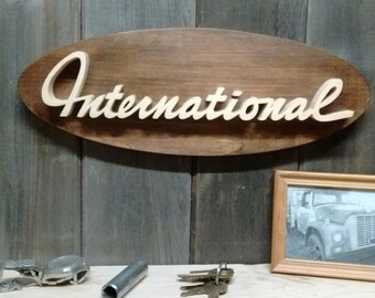 International Script Truck Emblem Oval Wall Plaque-Unique scroll saw automotive art created from wood for your garage, shop or man cave.