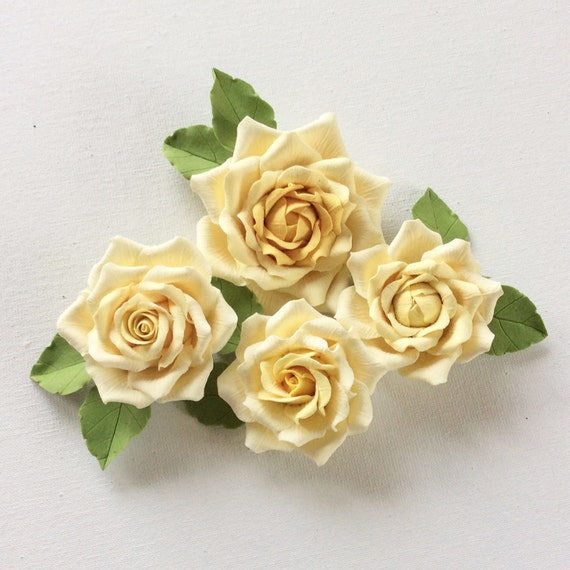 Small yellow rose brooch.