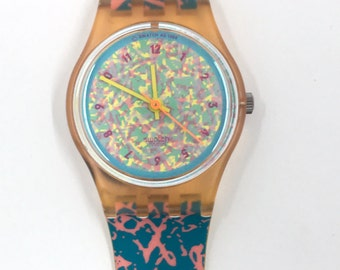 Vintage Swatch Watch Pink Drip LP107 1988.  New condition in box.  Working with fresh battery installed