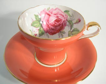 Aynsley Tea Cup and Saucer,  Aynsley Large Pink Rose tea cup and saucer, Orange tea cup and saucer with a Large pink rose.