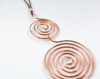 A copper necklace with a pendant totally handmade with pure copper wire and two spirals. A perfect gift for her in Celtic style.