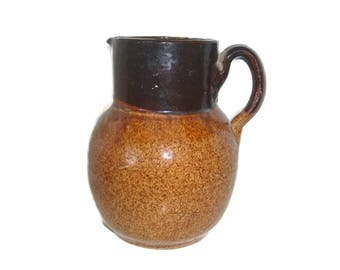 Antique stoneware slip glaze pitcher, circa early 1900s, primitive kitchen collectible