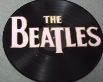 The  Beatles.hand painted 12ins vinyl disc