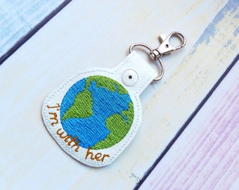I'm with her Snap Tab Feltie In the hoop Machine Embroidery Design. Earth Day Embroidery file. Instant download. Earth ITH key chain.