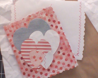 Card handmade with paper thread and fabric