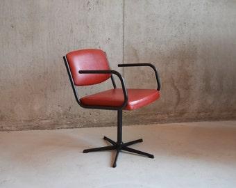 1970's mid century swivel office chair upholstered in red vinyl
