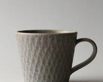 rusty grey faceted mug