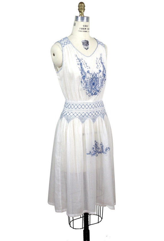 History of 1920s Day Dresses – Shop Day Dresses French Blue White 1920s Inspired Voile Heirloom Bohemia Dress by The Deco Haus $169.95 AT vintagedancer.com