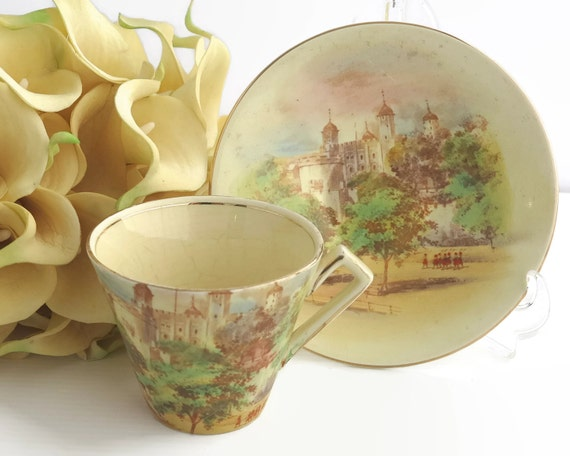 Vintage Royal Winton Grimwades cup and saucer, hand painted scenes of Tower of London with tiny orange soldiers in relief, England, 5443