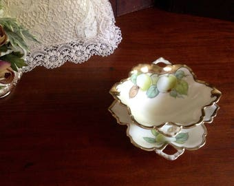 Hand painted Bavarian porcelain sauce bowl with under plate.  A tea table beauty with a variety of uses.