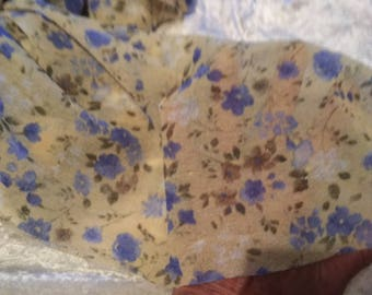 translucent pale yellow stretch knit with purple flowers fabric