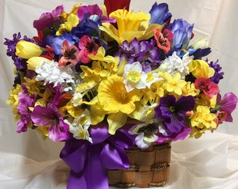 """Spring floral. Daffodil, pansy, tulip, iris, lilac, narcissus all in the 15x14"""" floral. 7x5"""" rope, slat basket. Purple bow. Faux flowers."""