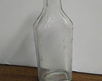 Antique 'King Oval' the 19th century medicinal glass bottle