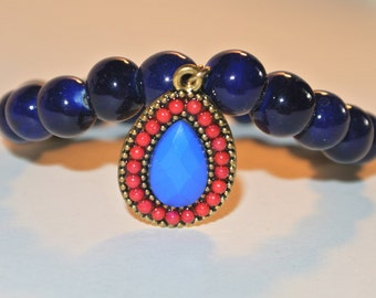 Navy Blue Beaded Bracelet with gold prink and royal blue charm