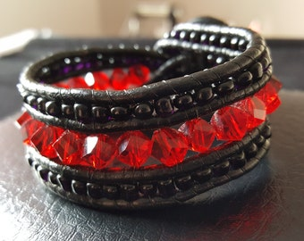 Leather bracelet with red crystals