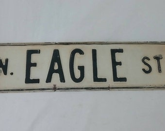 Vintage embossed steel north eagle street sign