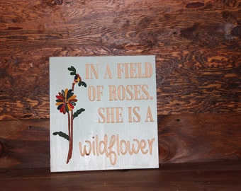 In a field of roses wooden sign