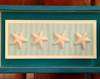 White Ceramic Starfish in a Shadow Box Wall Hanger. Layered Paper Accents and A Distressed Wooden Frame from Crafts by the Sea
