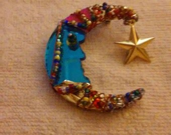 Beautiful half moon brooch.