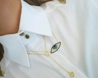 Eye and Lariat gold necklaces