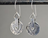Small stacked roller printed silver earrings.