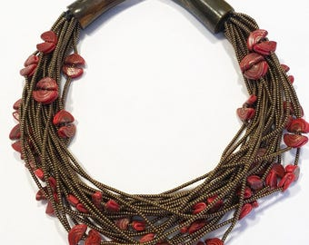 Bone necklace with Golden beads and glass beads.