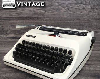 Gabrielle 25 Triumph White Typewriter Robotic cubic techno font Working Black Red Ribbon