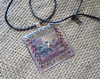 Stunning bereber pendant with leather cord