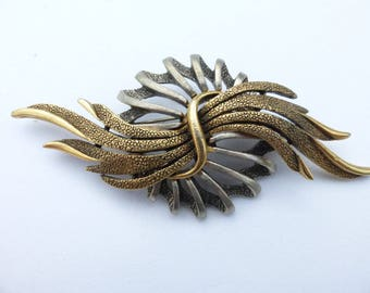 Art signed gold tone and silver tone brooch AA479