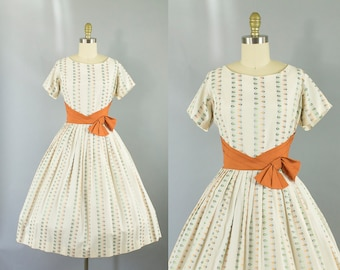 1950s cotton novelty print dress/ 50s orange  sash short sleeve dress/ medium
