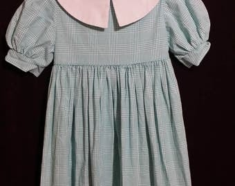 Adorable little girl vintage check dress, with puff sleeves, and cute white collar.