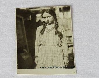 Vintage black and white photo of a nervy teenage girl, black and white photo, Vintage photo, Funny vintage photo, funny photo.