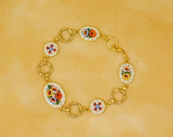Micro mosaic bracelet - red, violet, yellow and pink flowers on white background