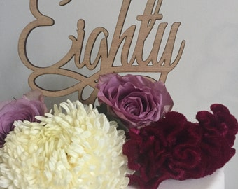 80th Birthday cake topper reads: Eighty