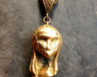 Dame of Brassempouy, solid brass locket