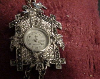 coo coo clock watch necklace